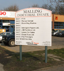 Easy to change name panels on the aluminium sign at Mallings Indudstrial estate in Lewes Sussex