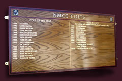 A crown grained oak honour board with a county colour contrasting maroon border produced to recognise the achievements the colts who play for the North Middlesex Cricket Club