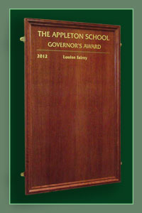 Solid oak framed honours board recording winners of the annual school governors award at the Appleton School