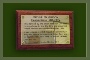 A brass plaque on oak backing board to commemorate Helen Musson; headmistress at The Abbey School in 1932