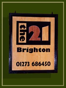 A handpainted hotel and guest house hanging sign in Brighton, Sussex