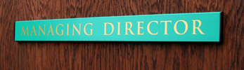 An easy to change office door nameplate sign