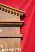Close view of solid oak mouldings used on this masonic lodge roll of honour name board