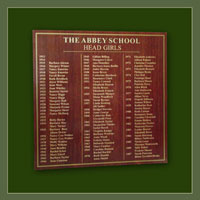 Head Girls honours board with gold lettering on red oak