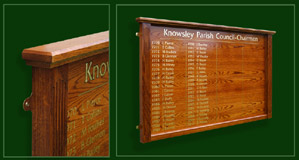 A crown cut veneered oak honours board with solid oak mouldings produced for a parish council near Liverpool