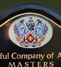 The coat of arms representing the Worshipful Company of Actuaries hand painted in oils and gold leaf by Streetwise UK