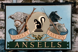 Stainless steel pub hanging sign at   the Market Tavern in Brecon, South Wales